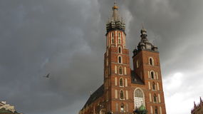 Krakow Cathedral. Old Krakow cathedral with a bird flying and a nasty storm approaching from behind Stock Photography