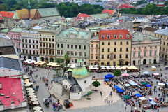 Krakow city centre. KRAKOW, POLAND - JULY 21: View of the Main Square of Krakow historical centre on July 21, 2012. Krakow is one the most beautiful and visited Stock Photography