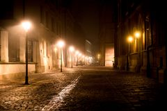 Krakow Cobbled Road. Krakow After Dark. Foggy Cobbled Road at Night. Downtown Cracow, Poland, Europe Royalty Free Stock Images