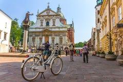 Krakow (Cracow) - cykla dengamla staden Arkivbilder