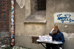 Krakow Cracow, Poland. Street entertainer. A street entertainer dressed up as a horse, playing on a keyboard, gathering money for an engagement ring. Cracow Stock Photo