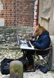 Krakow Cracow, Poland. Street entertainer. A street entertainer dressed up as a horse, playing on a keyboard. Cracow Krakow Poland, winter 2016 Stock Photos