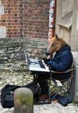 Krakow Cracow, Poland. Street entertainer Stock Photos