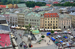 Krakow downtown top view. KRAKOW, POLAND - JULE 21: Tourists walk on the main square of the city historical center on Jule 21, 2012. Krakow is one of most famous Royalty Free Stock Photo