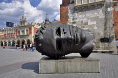 Krakow - head sculpture. Stock Image