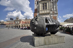 Krakow - head sculpture. Stock Photo