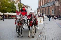 Krakow horse carriage. Krakow, Poland - October 27, 2016: Traditional horse carriage waiting for passengers on Krakow's main market square Stock Image