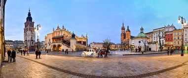 Krakow main square. Krakow, Poland, panorama shows the main monuments in the main square, from the right: Church of St. Wojciech, St. Mary's Church, the old Stock Photography