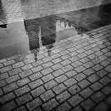 Krakow, Market Square. Artistic look in black and white. The historic city. The market in the old town, view reflections in pavement of St. Mary's Church Stock Images