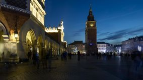 Krakow market square time lapse. Time lapse sequence of the crowded Rynek Glowny, the main square in the center of the old town of Krakow, during Christmas stock video footage