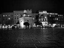Krakow by night, Market Square. Artistic look in black and white. Stock Image