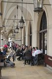 Krakow, Old Town. Krakow, Poland - March 11, 2018: Main Market Square, Cloth Hall. Side arcades with numerous pubs under them Royalty Free Stock Photography