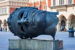 KRAKOW, POLÔNIA - EM JUNHO DE 2012: Eros Head enfaixado Imagem de Stock Royalty Free