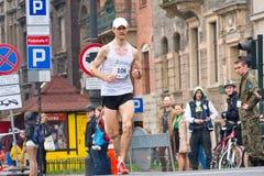 KRAKOW, POLAND - APRIL 28 : Cracovia Marathon. Andrzej Lachowski on the city streets Royalty Free Stock Photography