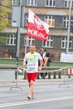 KRAKOW, POLAND - APRIL 28 : Cracovia Marathon. Barefoot runner on the city streets Stock Photo