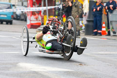 KRAKOW, POLAND - APRIL 28 : Cracovia Marathon.Handicapped man marathon runners in a wheelchair on the city streets Stock Photography