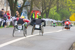 KRAKOW, POLAND - APRIL 28 : Cracovia Marathon.Handicapped man marathon runners in a wheelchair on the city streets Stock Images
