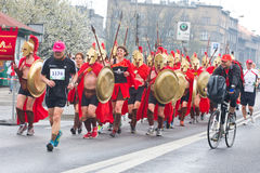 KRAKOW, POLAND - APRIL 28 : Cracovia Marathon. Spartans Children charity group speed on the city streets Stock Images