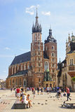 KRAKOW, POLAND - AUGUST 1, 2015: The historic Mariacka Cathedral Stock Images