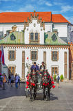 Horse carriage on Florianska street. Krakow/Poland- August 15, 2017: horse carriage on Florianska street with tourists walking and taking photo on background royalty free stock images