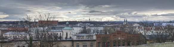 Large panoramic view of Krakow old town at cold, rainy day, Poland royalty free stock photo