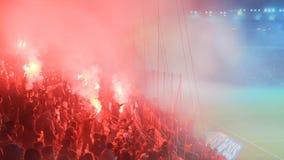 A Polish Derby. KRAKOW, POLAND-DECEMBER 13, 2017: Polish soccer fans lighting smoke flares at Cracovia Stadium, during the Polish Premiere League match Cracovia Royalty Free Stock Photo