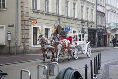 Street in old medieval town of Krakow, Poland Stock Photos