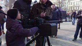 KRAKOW, POLAND - JANUARY, 14, 2017 Boy examines heavy machine gun at military show. 4K clip stock video