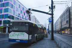 KRAKOW, POLAND, January 28, 2017 electric bus is charging at a b stock photos