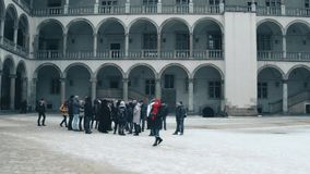 KRAKOW, POLAND - JANUARY, 14, 2017 Guided group tour at inner courtyard Wawel Castle. Local landmark and popular Stock Photos