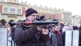 KRAKOW, POLAND - JANUARY, 14, 2017 Man examines RPG grenade launcher at military show Royalty Free Stock Photos