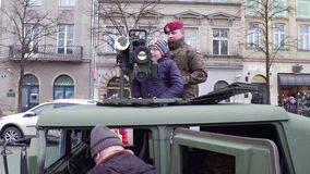 KRAKOW, POLAND - JANUARY, 14, 2017 People explore HMMWV armored vehicle with TOW anti-tank complex at WOSP military show stock video