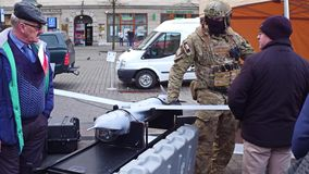 KRAKOW, POLAND - JANUARY, 14, 2017 Special force soldier demonstrates modern reconnaissance drone. WOSP military show Stock Photography