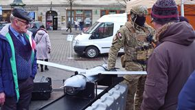 KRAKOW, POLAND - JANUARY, 14, 2017 Special force soldier demonstrates modern reconnaissance drone. WOSP military show stock footage