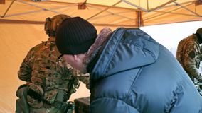 KRAKOW, POLAND - JANUARY, 14, 2017 Special force soldier wearing camouflage uniform demonstrates his modern gear. WOSP stock video