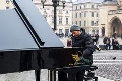 KRAKOW, POLAND, January 27, 2017  A street musician Arne Schmitt. Plays the piano on the main Rynok square in Krakow Stock Photo