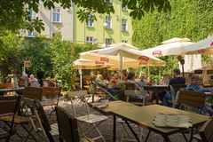 Bar in Kazimierz. Krakow, Poland - July 13th 2018. Customers enjoy drinks at a popular outdoor bar in the Kazimierz district of Krakow Royalty Free Stock Images