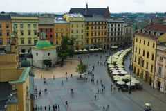 Rynek Glowny. Krakow, Poland - July 9th 2018. The historic Rynek Glowny square in old town Krakow viewed from the Town Hall Tower Stock Images