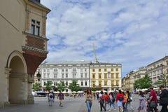 Rynek Glowny. Krakow, Poland - July 8th 2018. Tourists walk around the historic Rynek Glowny square in old town Krakow Stock Photo