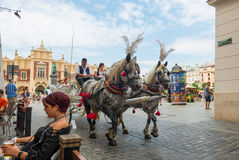 KRAKOW, POLAND - JULY 27, 2013: Traditional horse carriage with Royalty Free Stock Photo
