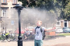 Krakow, Poland, July 28, 2018, A young guy is standing under a s stock images