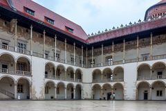 KRAKOW, POLAND - JUNE, 2012: Arcades and courtyard of Wawel castle. Famous renaissanse building Stock Photo