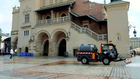The cleaning vehicle next the Cloth Hall in Krakow, Poland stock video footage