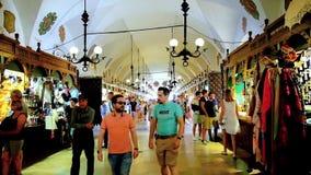Tourists in Sukiennice Cloth Hall in Krakow, Poland stock video