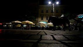 Night carriage riding, Krakow, Poland stock footage