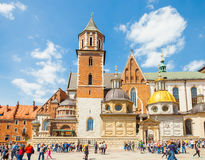 KRAKOW, POLAND - JUNE 08, 2016: Lots of tourists visiting historical complex of Wawel Royal Castle and Cathedral in Krakow, Poland Royalty Free Stock Images