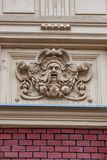 KRAKOW, POLAND - JUNE, 2012: MASCARON ON WALL Royalty Free Stock Photography