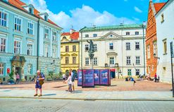 The small square in Krakow, Poland. KRAKOW, POLAND - JUNE 11, 2018: The small Mary Magdalene Square surrounded with beautiful medieval edifices, on June 11 in royalty free stock photos