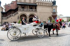 Tourist sit in carriage with horses in Krakow, Poland Royalty Free Stock Images