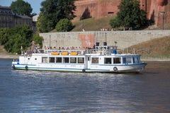 KRAKOW, POLAND - JUNE 9, 2018. Tourists in Motor boat Legend on Vistula River near Wawel Castle in Krakow.  stock images